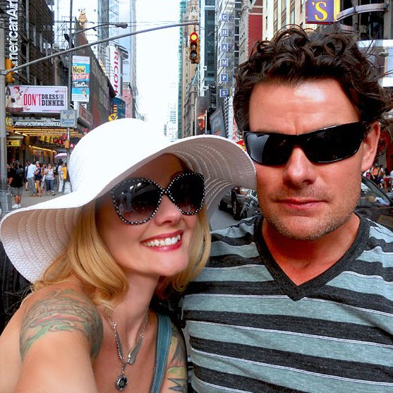 DH & I on a pedicab in NYC - Like I said, BIG hats, too (even better if they're floppy)!