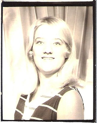 My mother in the photobooth in her early 20's.