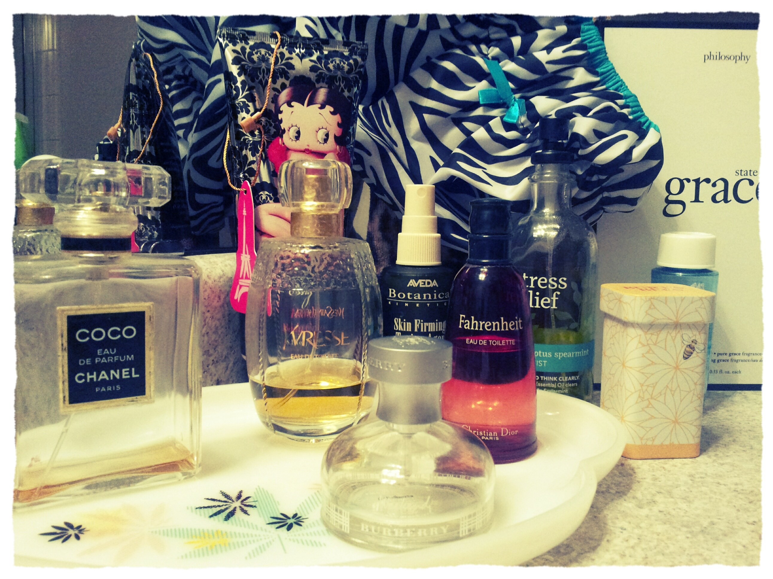My graveyard tray of constants & just droplets of my parfums préférés. These all take me on a journey through the nose.