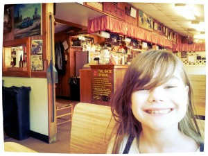 Mini Maven getting ready to tear into some ribs, fried okra, & hush puppies! Raisin' another foodie...