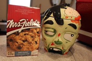 A zombie cookie jar! My DH loves zombies AND cookies! When we first met, I used to make him homemade cookies (& truffles) all of the time. I could easily collect cookie jars, but I can't allow myself one more collection (especially in the kitchen). I already have trouble with salt & pepper shakers, which only got worse after publishing my second book, Don't Rub Salt in the Heartbreak. Now other people give them to me as well!