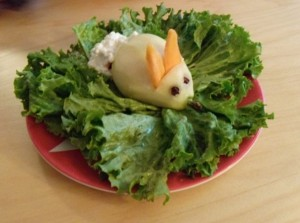 "Almost the entire month of March I make Mini Maven all kinds of Easter-y meals. Here's a fine example: a peeled pear on a bed of ""grass"" with clove eyes, carrot ears, and a cottage cheese ""cottontail"". She ""eats it up""!"