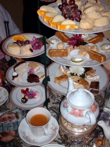 A photo of our typical Mad Hatter's Tea Party with petit fours, tea, and lemon curd aplenty!