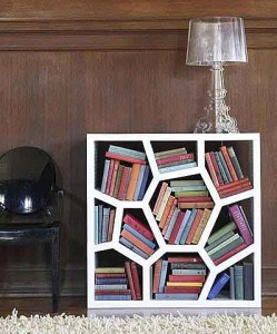 This is one of the simpler ideas, especially for paperbacks. I was thinking  certain shoe racks could store books quite well, in this mishmash sort of way. It would be a really swell idea for a child's bathroom while potty-training.