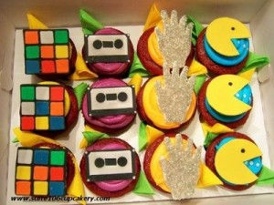 I found these totally tubular '80s-themed retro cupcakes on 2 time winners & Food Network champions, Rebecca & Christy's, blog for Suite 106 Cupcakery. These would NOT gag me with a spoon!