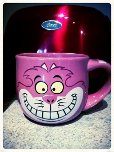 My VERY favorite cartoon character is Cheshire Cat! #purrrrr This mug is so colossal that I like to drink more than decaf out of it ~ I like to eat soup, cereal & ice cream out of it, too. He's a versatile pussycat. :) This was originally from the Disney Store, but I don't believe they carry it anymore (since I've been carrying it around for over 15 years), but check out THIS cool *disappearing* Cheshire mug! Yes, check it out my sweets who love me galore. ::winkwink:: ::hinthint::