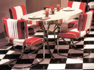 "On the same note... I will never quit having a mad crush on all sorts of '50s dinette sets, and in my case, the bolder the better! Our entire kitchen in the new digs is ""Gumball Red"". There's nothing quite like classic checkerboard flooring with a glittery, red, chromed out dinette to make a dining room feel like it should have a jukebox and all meals should be dished out with love...... on roller skates!"